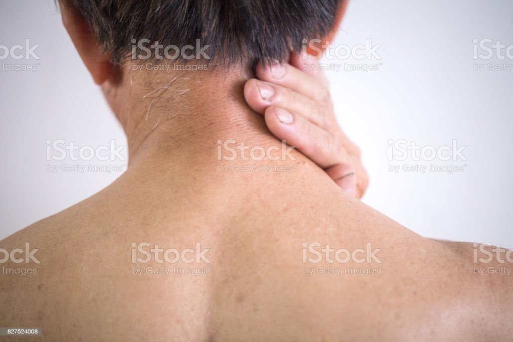 old man hands touch his neck rear view