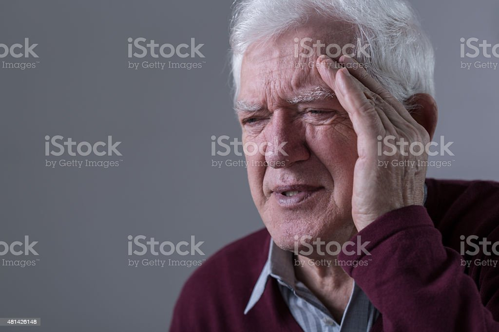 Old man has headache stock photo