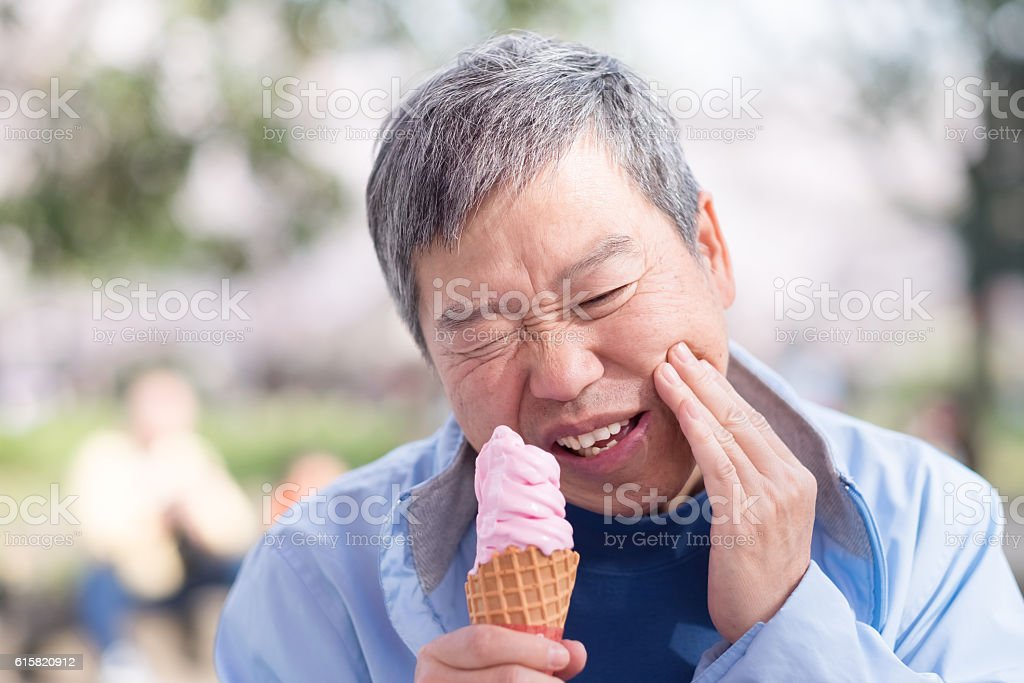 old man have sensitive teeth stock photo