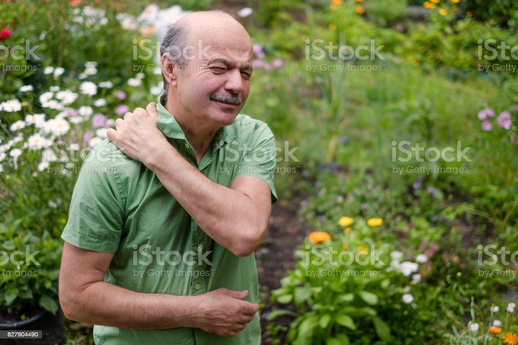 Old man having lumbago pain stock photo