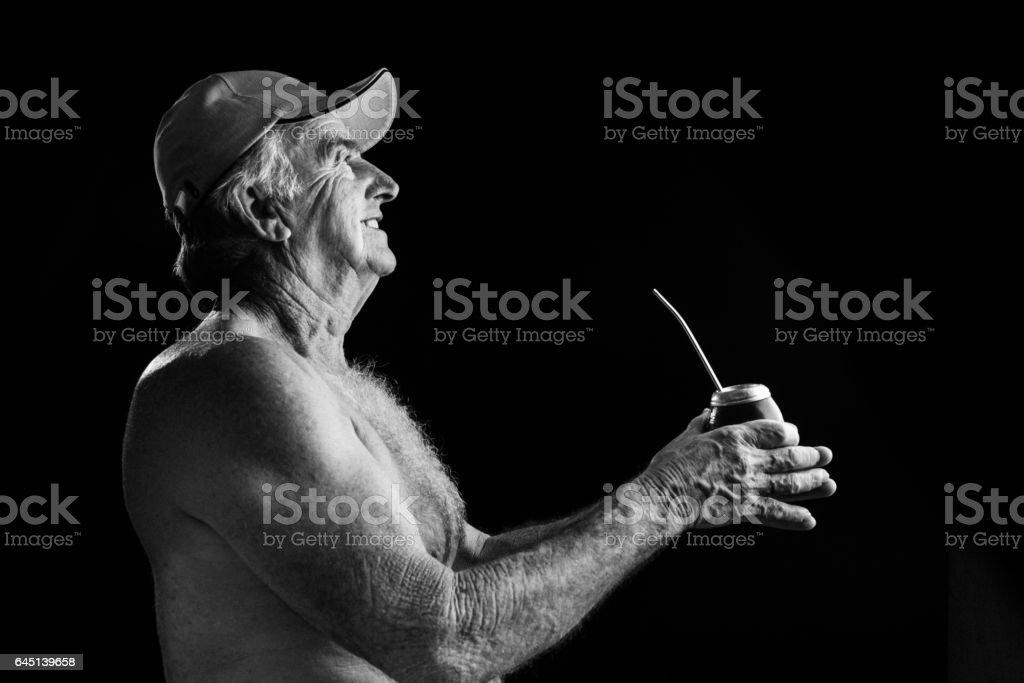 Old man holding a Yerba Mate, Chimarrão stock photo