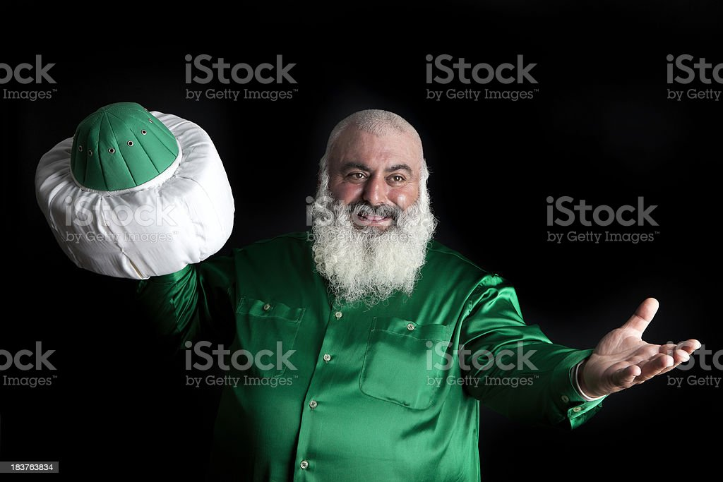 Old man holding his hat. stock photo