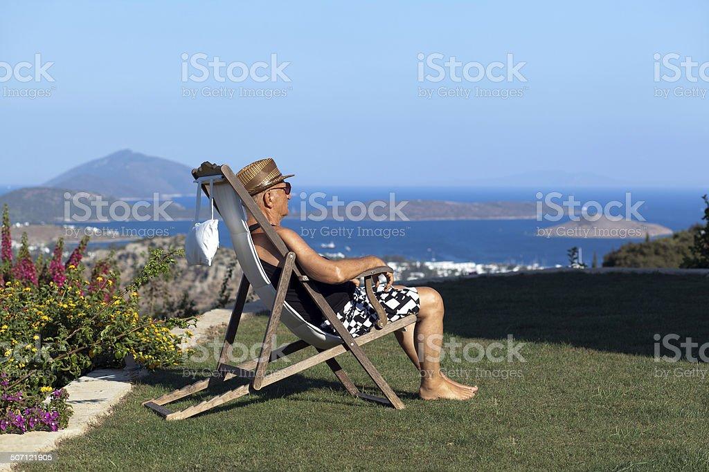 Old man in a garden stock photo