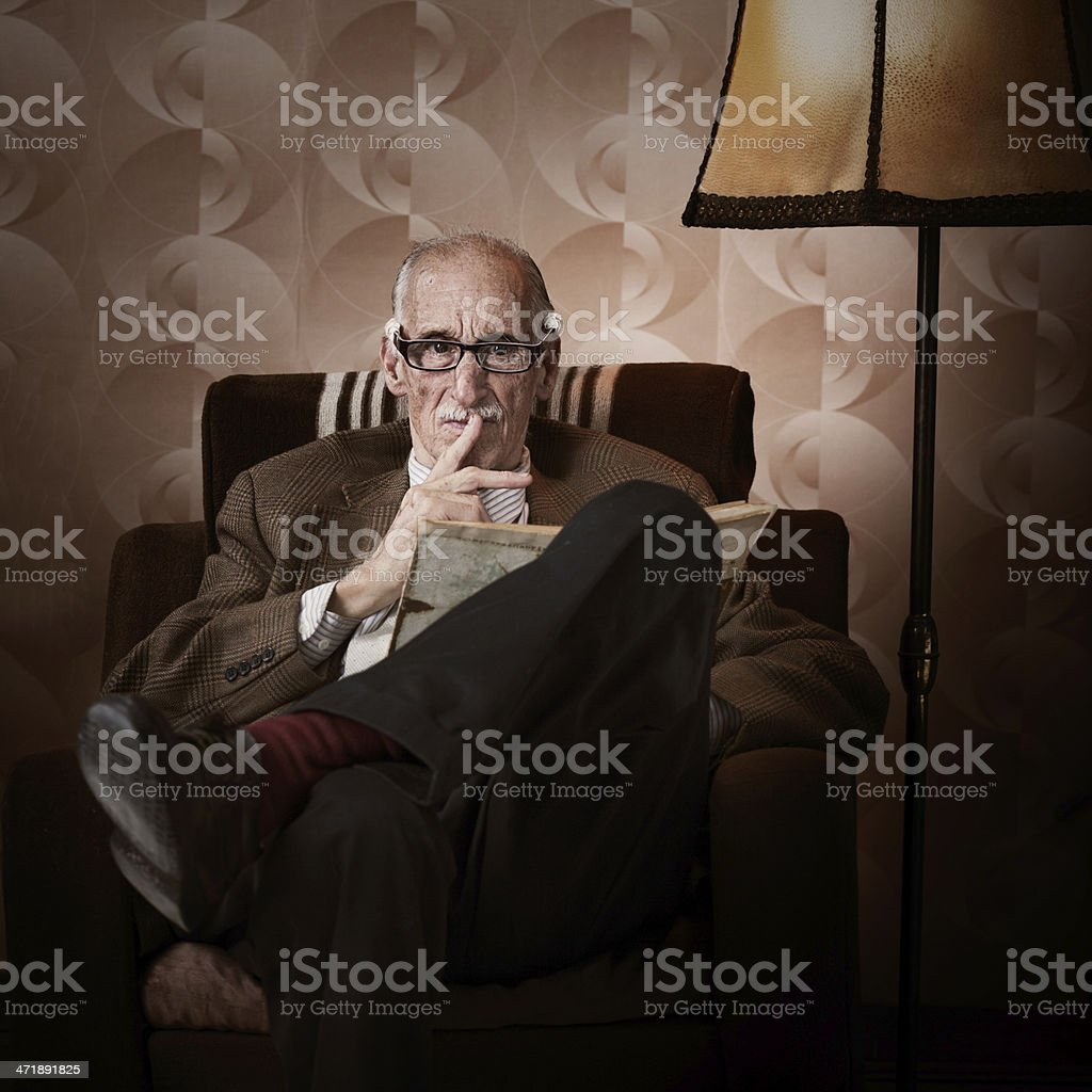 Old man in living room royalty-free stock photo