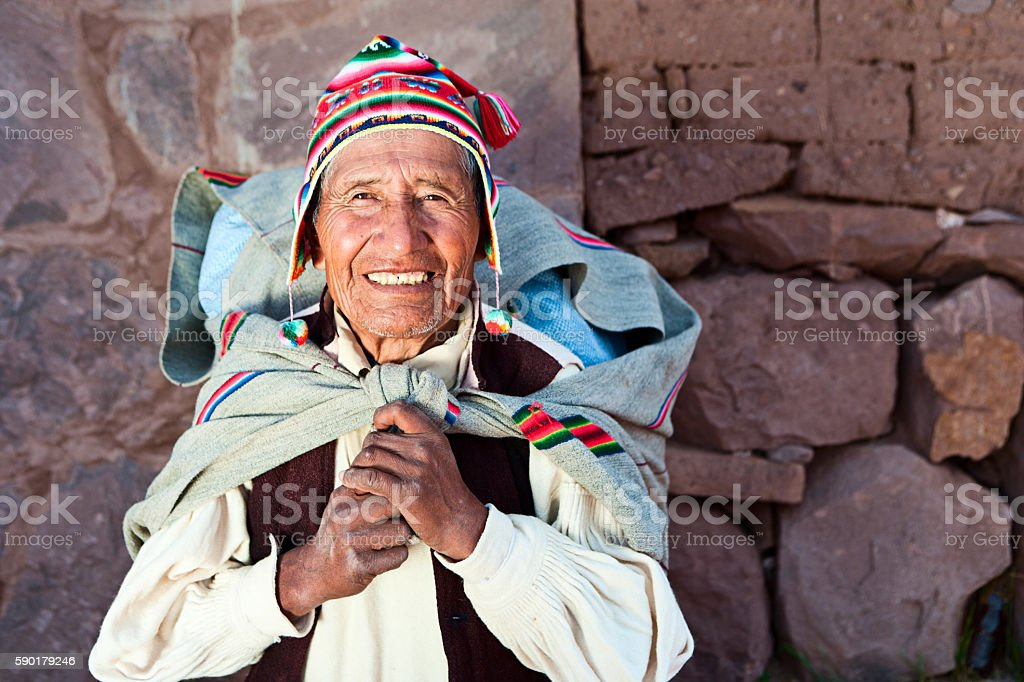 Old man in national clothing on Taquile Island, Peru stock photo