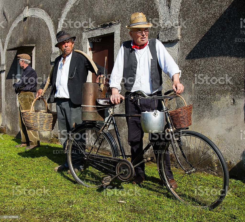 Old man in traditional peasant clothing - retro style stock photo