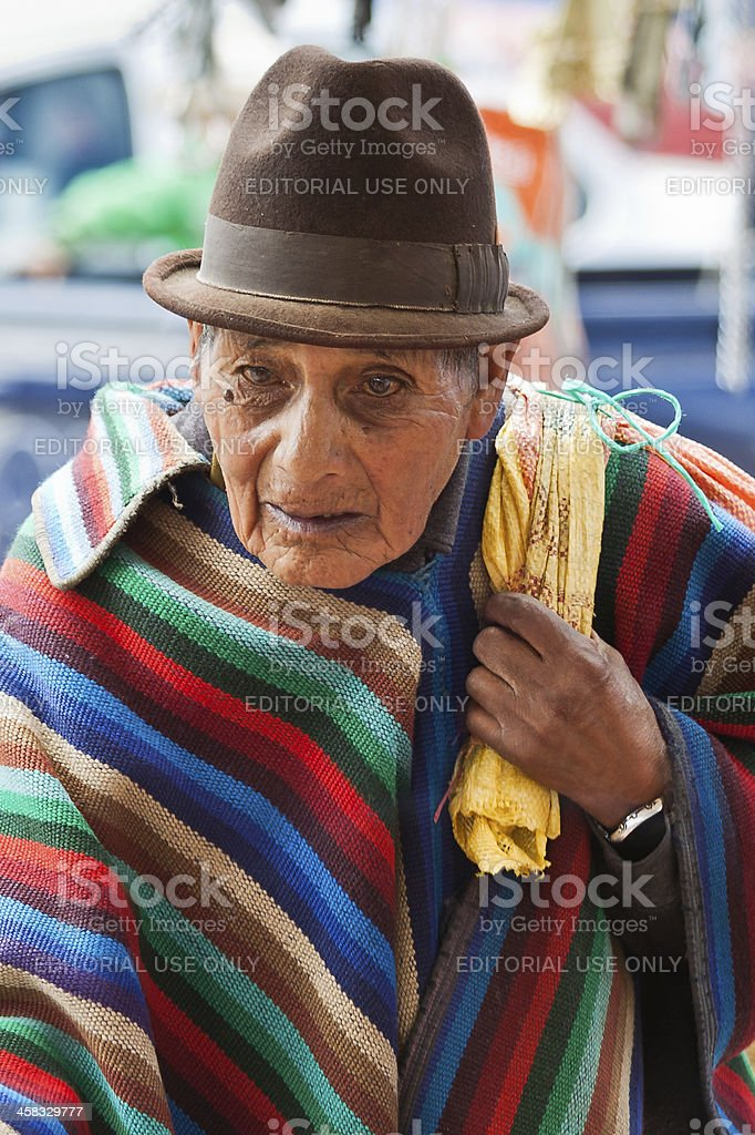 Old man in traditional striped poncho, Saquisili royalty-free stock photo