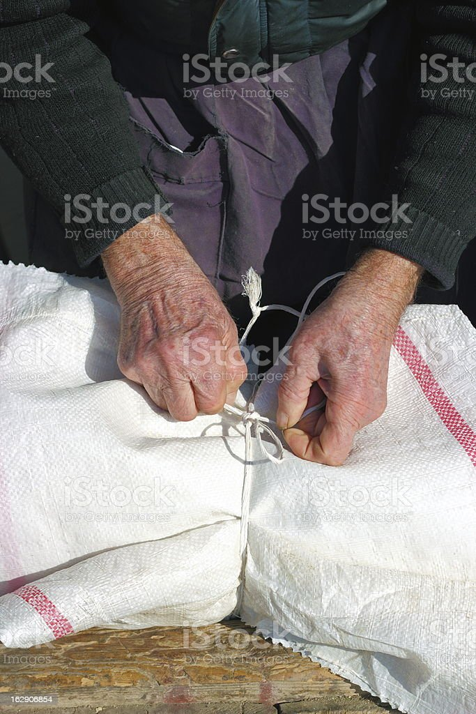 old man making a knot royalty-free stock photo