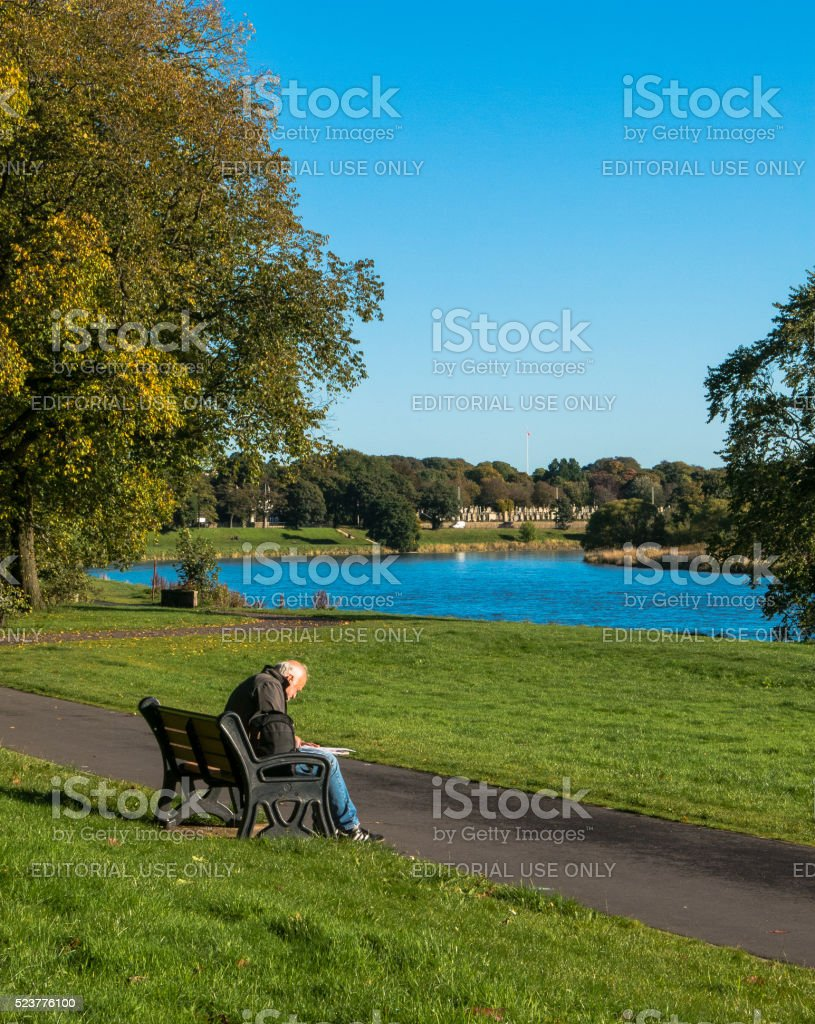 Old Man on bench at River Dee, Aberdeen stock photo