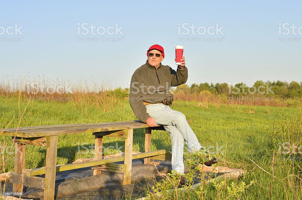 Old Man On Bench With Coffee royalty-free stock photo