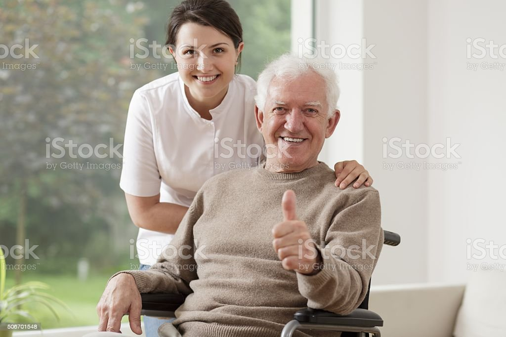 Old man on wheelchair stock photo