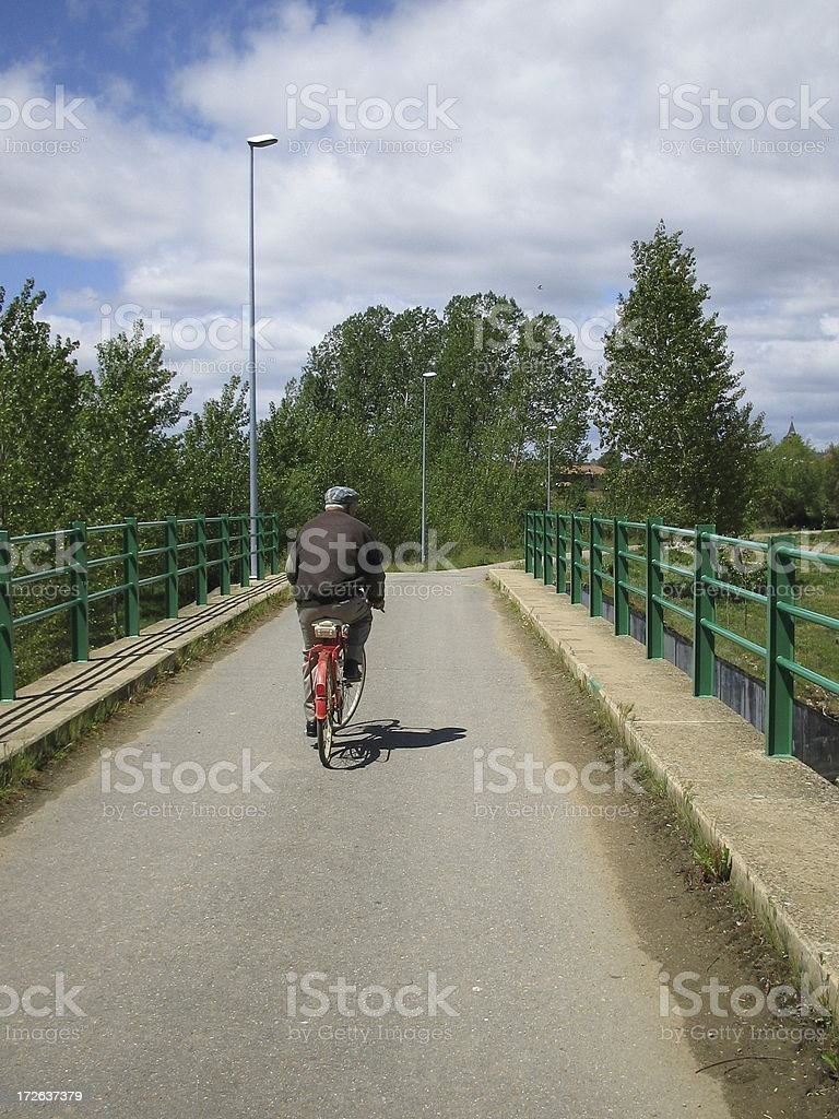 Old man over bicycle royalty-free stock photo