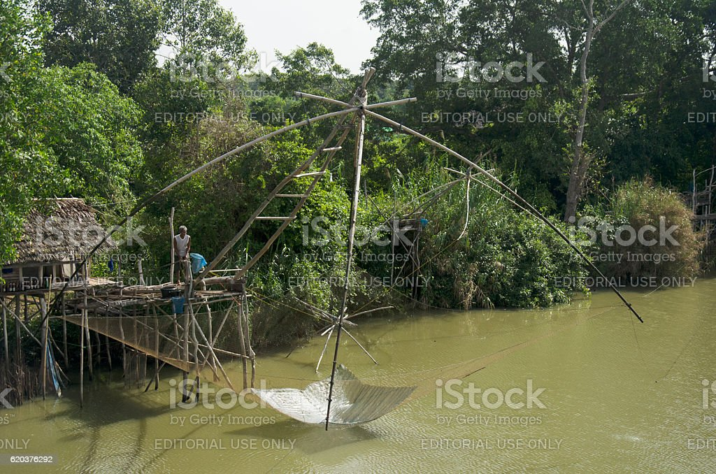 Old man people use fishing lift and dip net machine stock photo