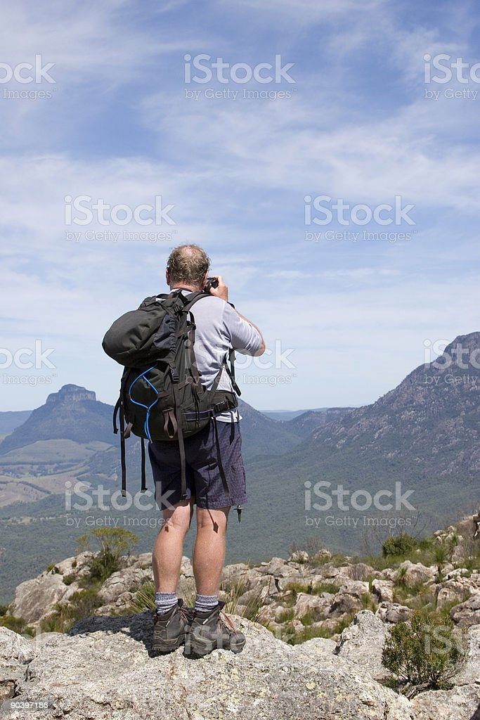 old man photographer on mountain top 2 royalty-free stock photo