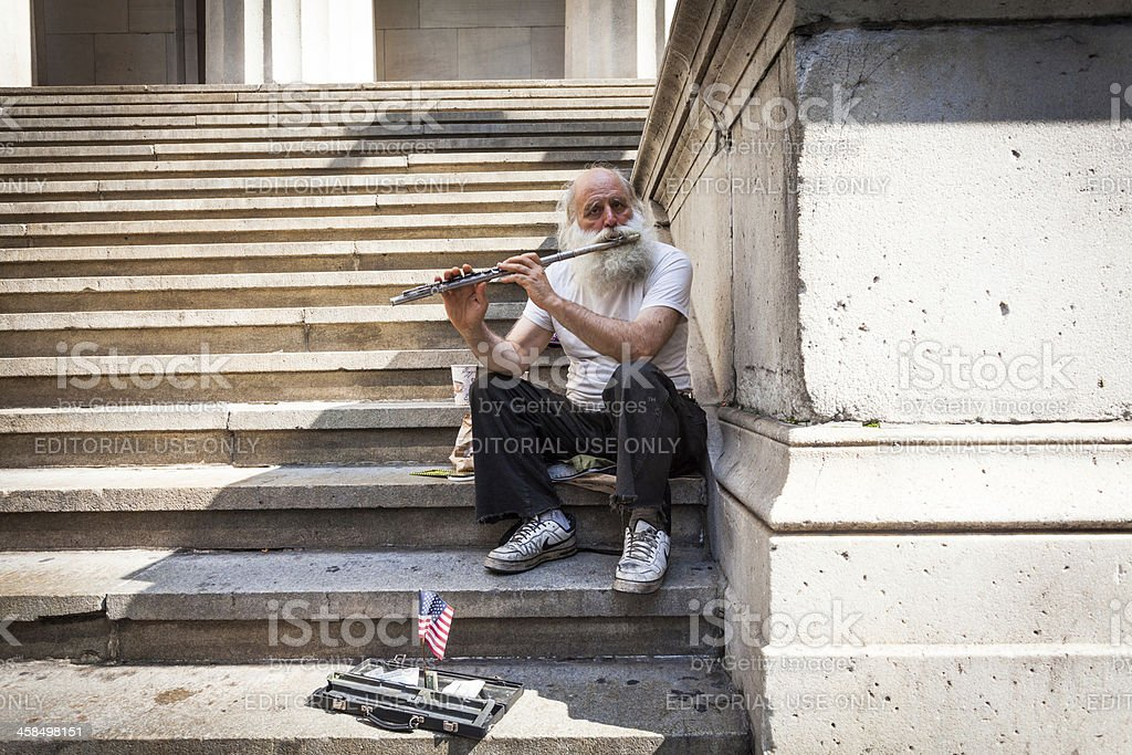 Old Man Playing Flute in New York City royalty-free stock photo
