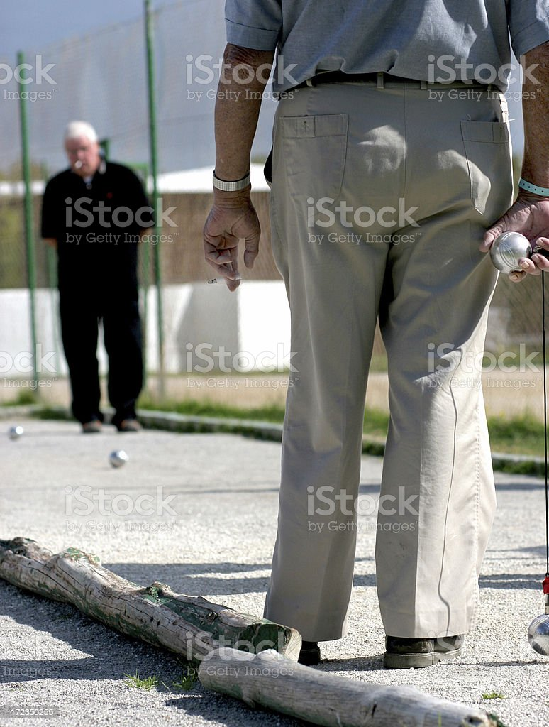Old man plays of bowls, french game stock photo