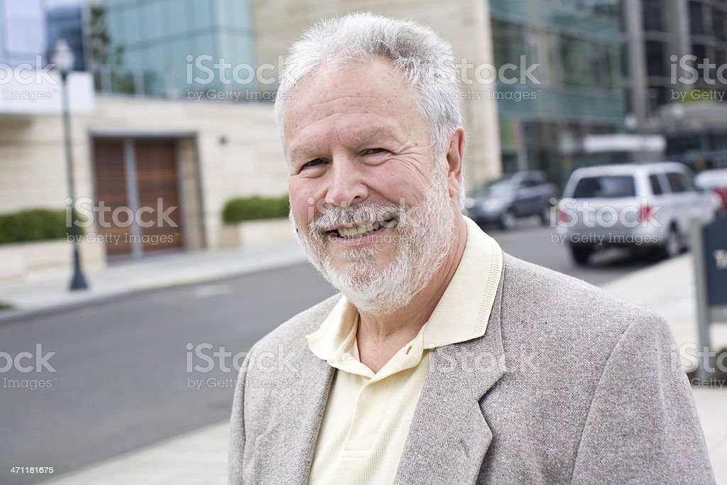 Old man portrait on a city street royalty-free stock photo