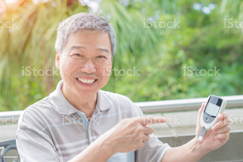 old man prevention of diabetes stock photo