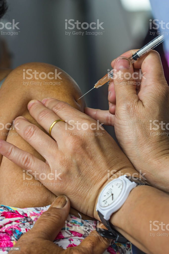 Old man receives Vaccine Injection stock photo