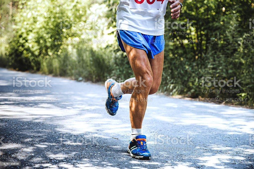 old man runs marathon stock photo