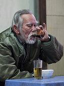 Old man savoring the intense pleasure of vietnamese coffee