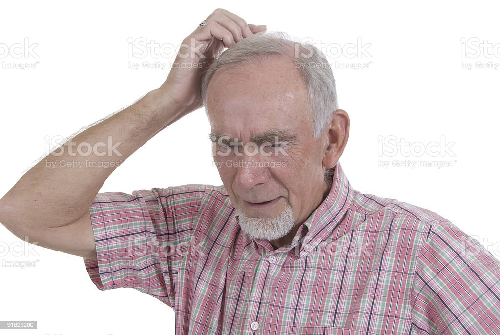 Old man scratching his head in puzzlement stock photo