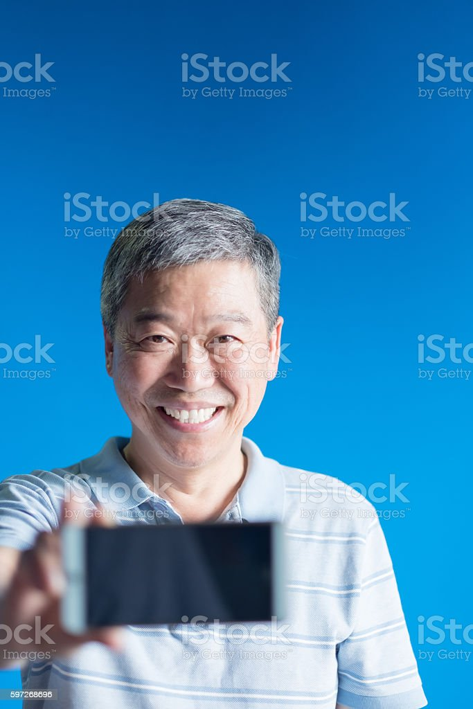 old man show smart phone stock photo