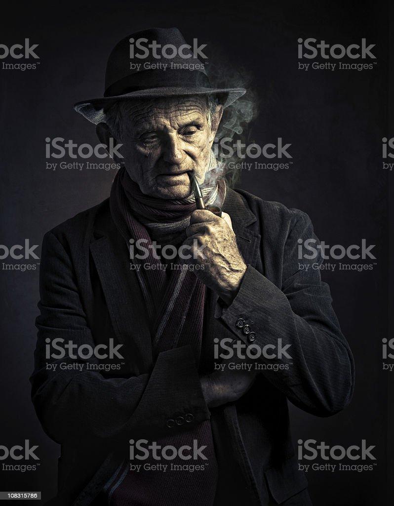 old man smoking a pipe stock photo
