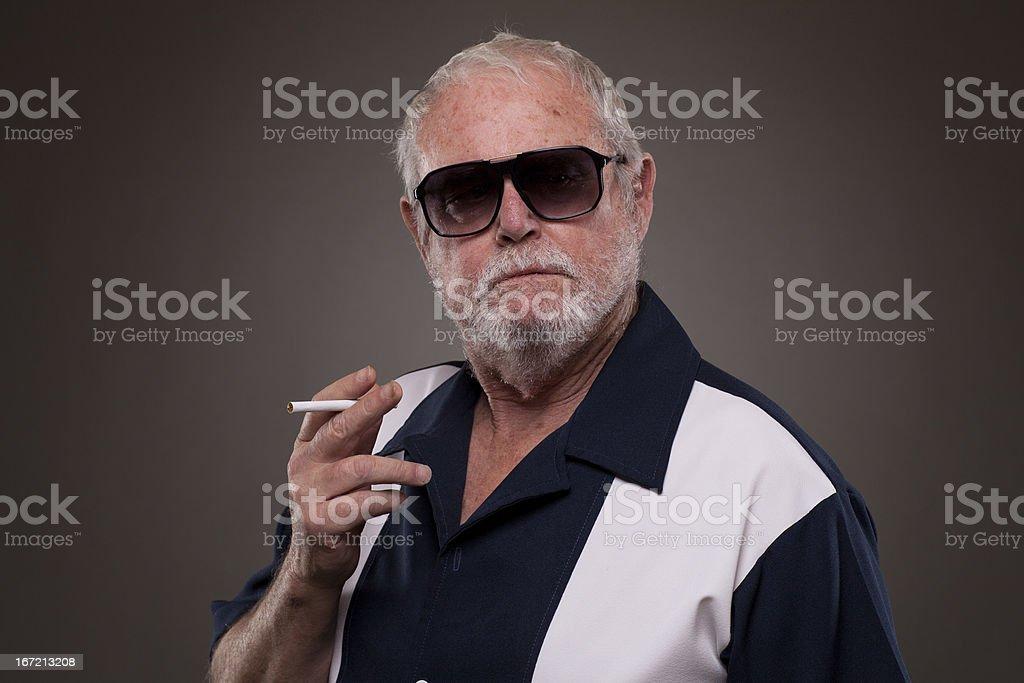 Old Man smoking cigarette royalty-free stock photo