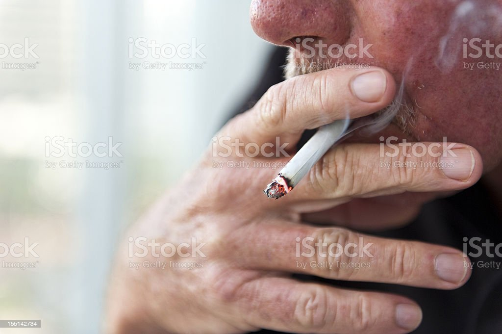 Old Man Smoking stock photo