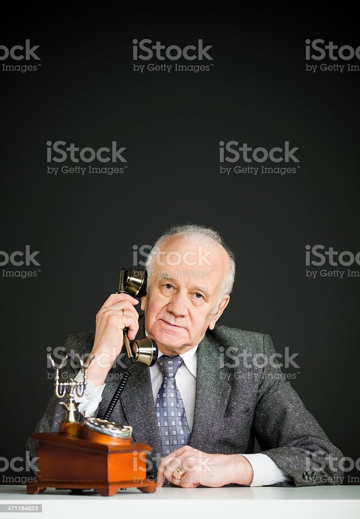 Old man speaking over telephone royalty-free stock photo