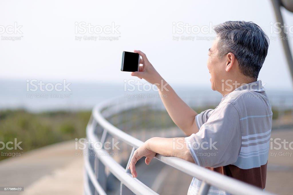 old man take selfie stock photo
