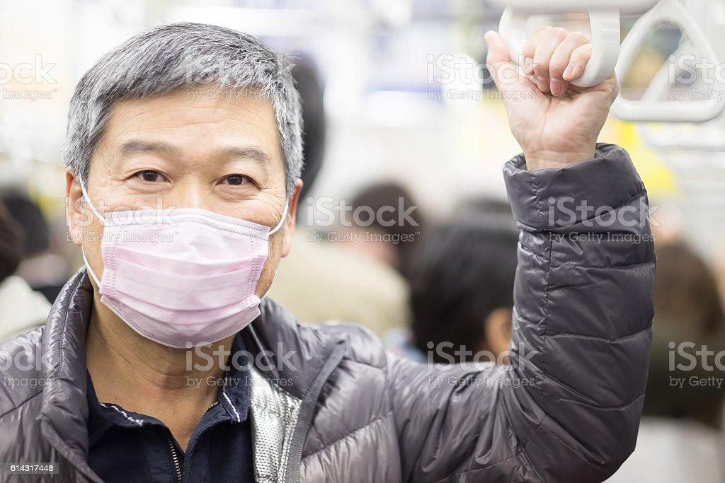 old man take the subway stock photo