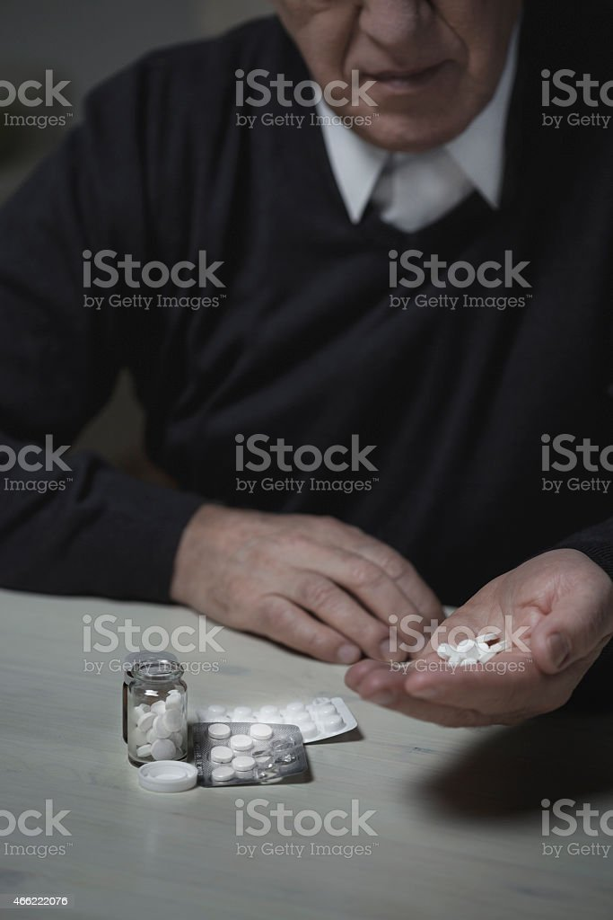 Old man taking hypnotics stock photo