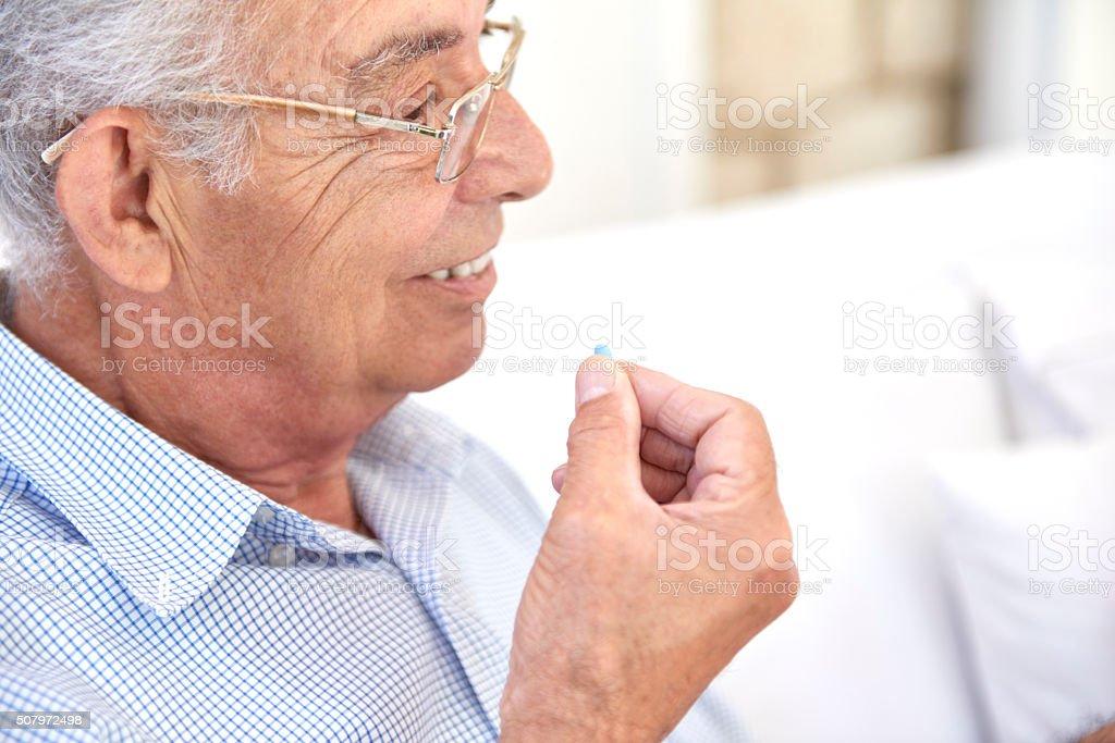Old man taking medication stock photo