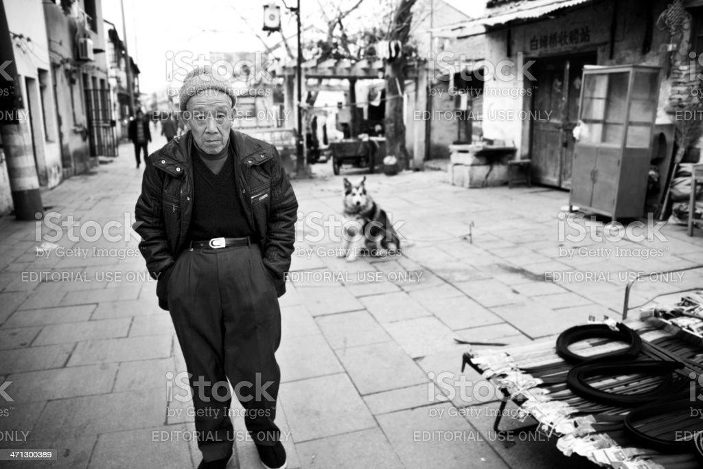 Old man walking on Shan Tang Street stock photo