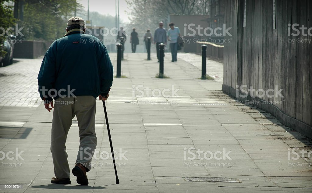 Old man walking with cane royalty-free stock photo