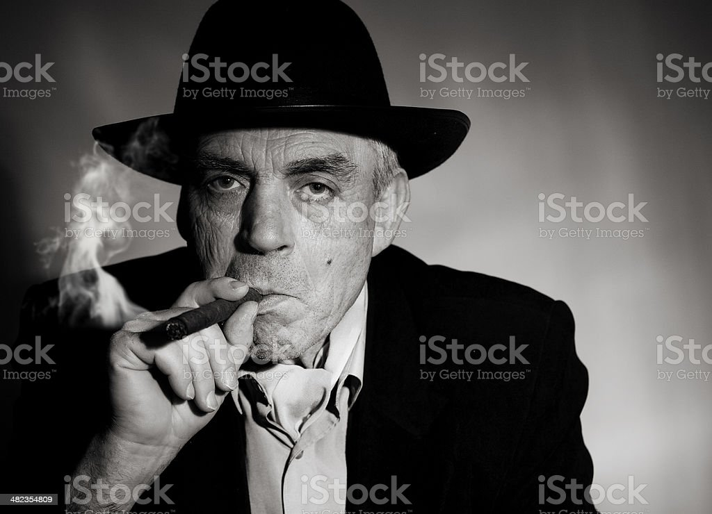 Old man with cigar stock photo