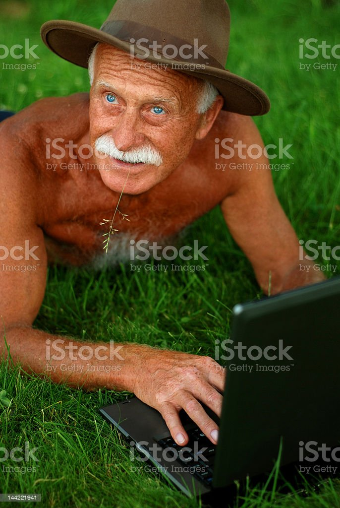 Old man with computer royalty-free stock photo