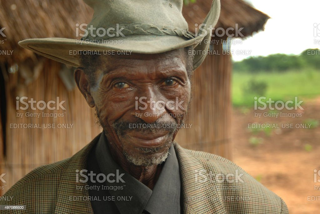 Old man with hat  in a village in Namibia stock photo