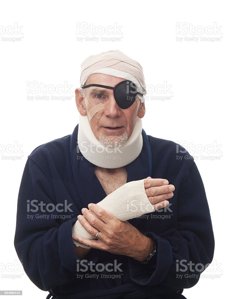 Old man with head, neck, and wrist injuries stock photo