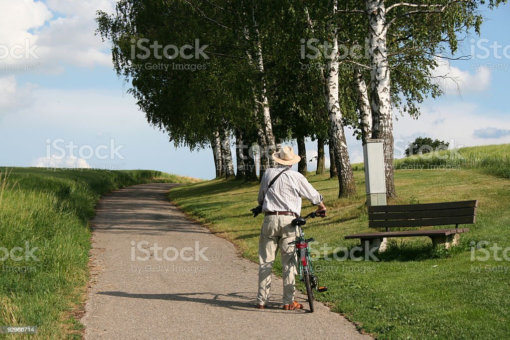 old man with his bike stock photo