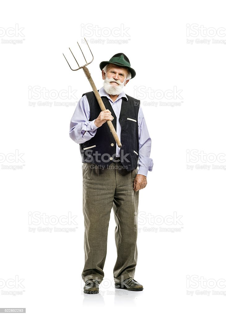 Old man with pitchfork isolated stock photo