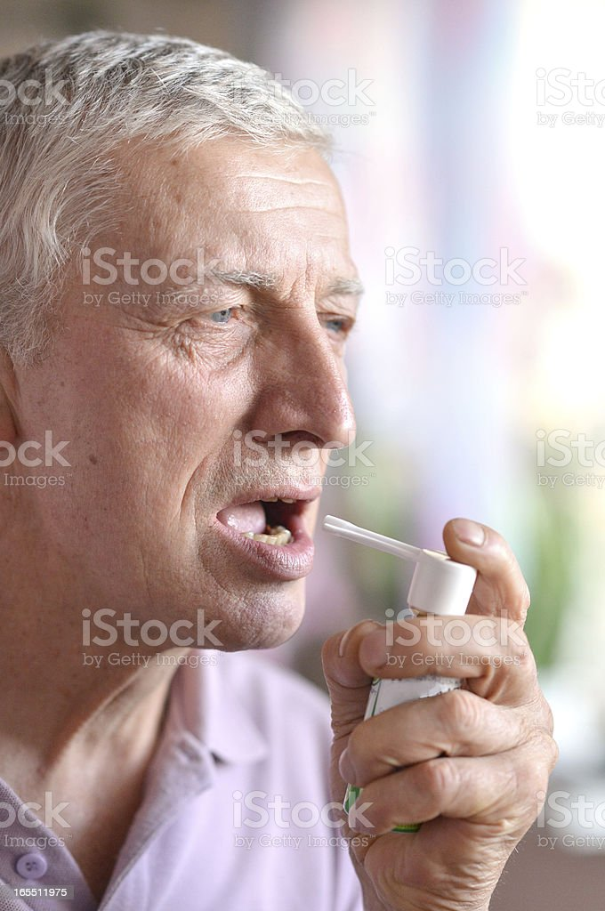 old man with spray inhaler royalty-free stock photo