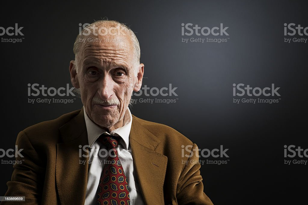 Old mand looking at camera with copy space. royalty-free stock photo