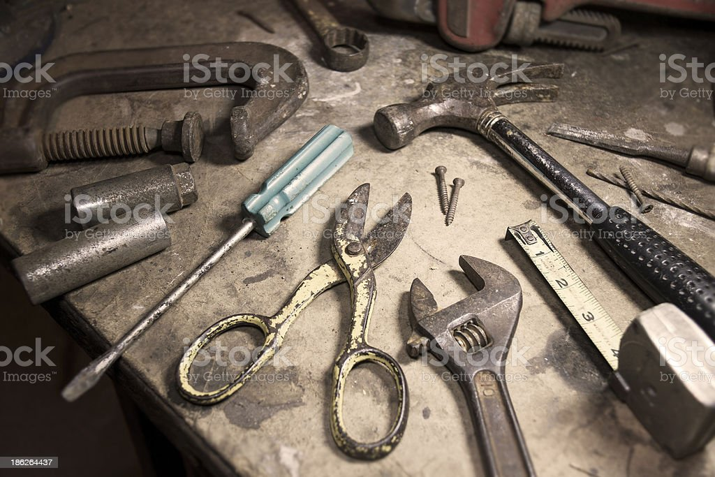 Old mans rusty tools sitting on a wooden workbench stock photo
