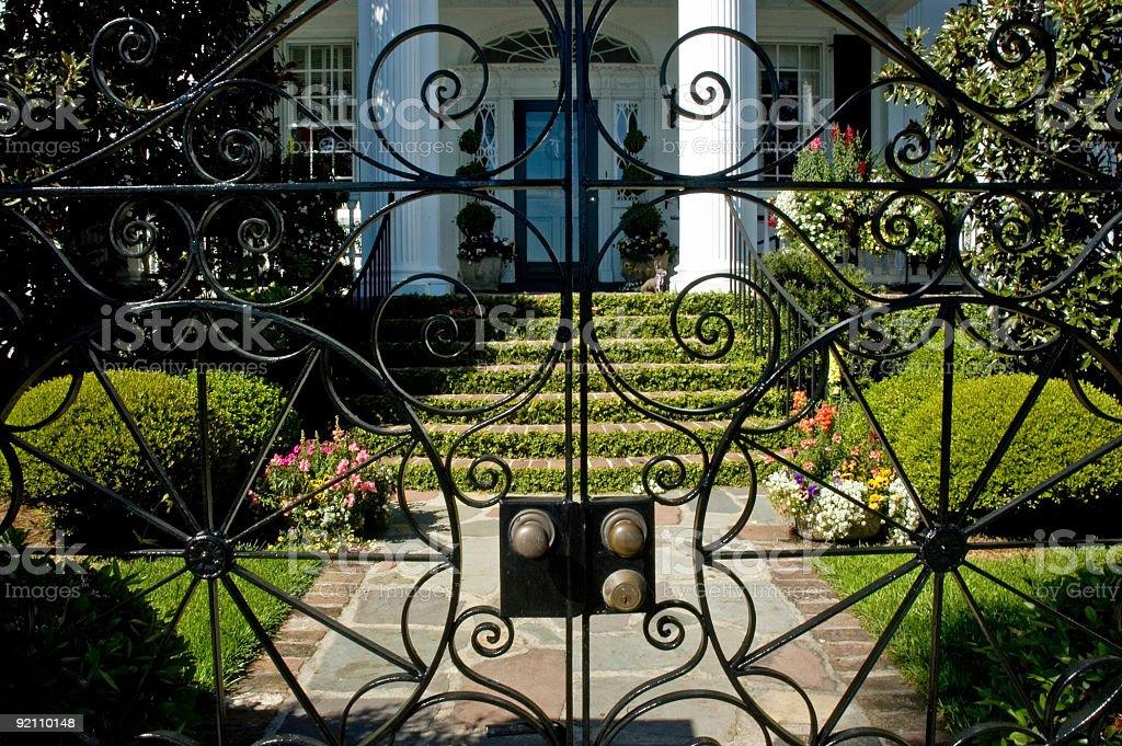old mansion throught iron gate stock photo