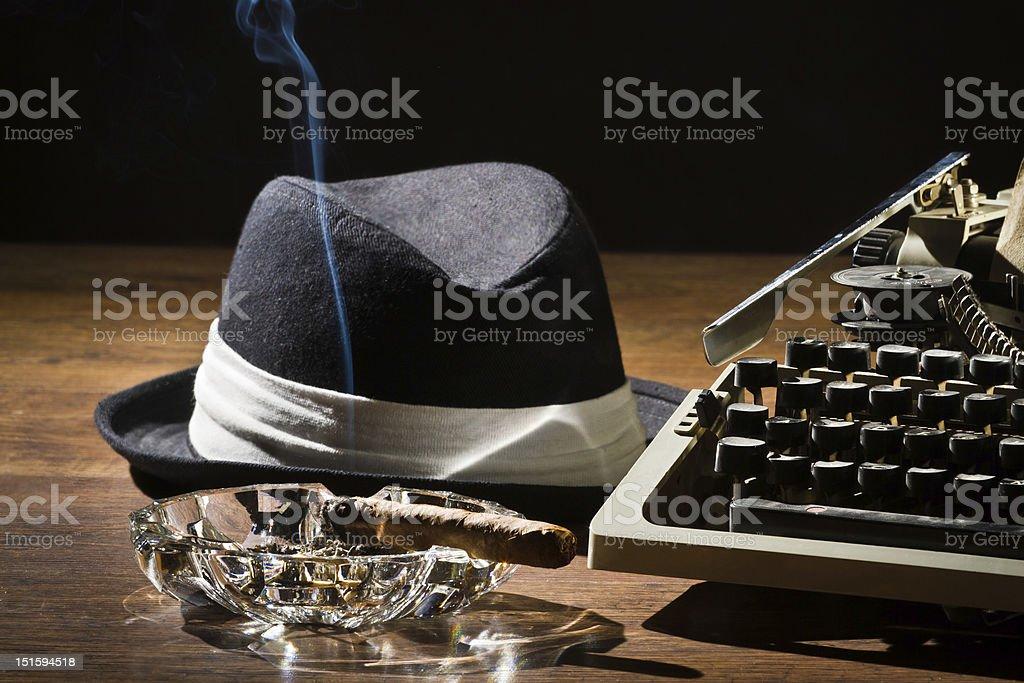 Old manual typewriter cigar and hat stock photo