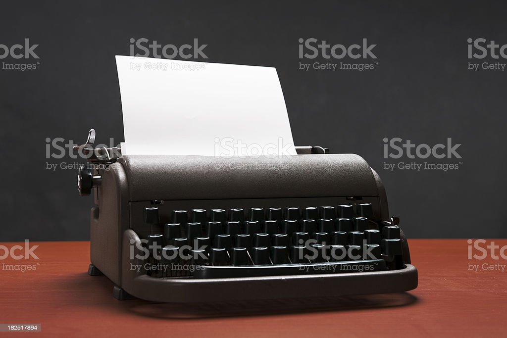 Old manual typewriter with blank paper for your message royalty-free stock photo
