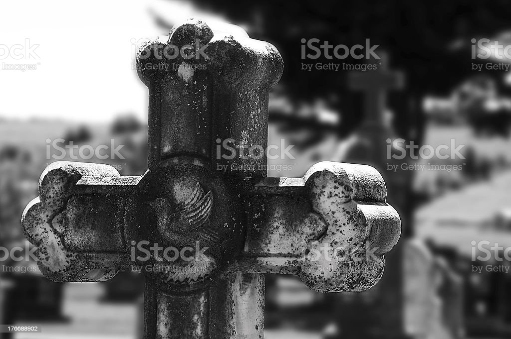 Old marble cross at a cemetery stock photo